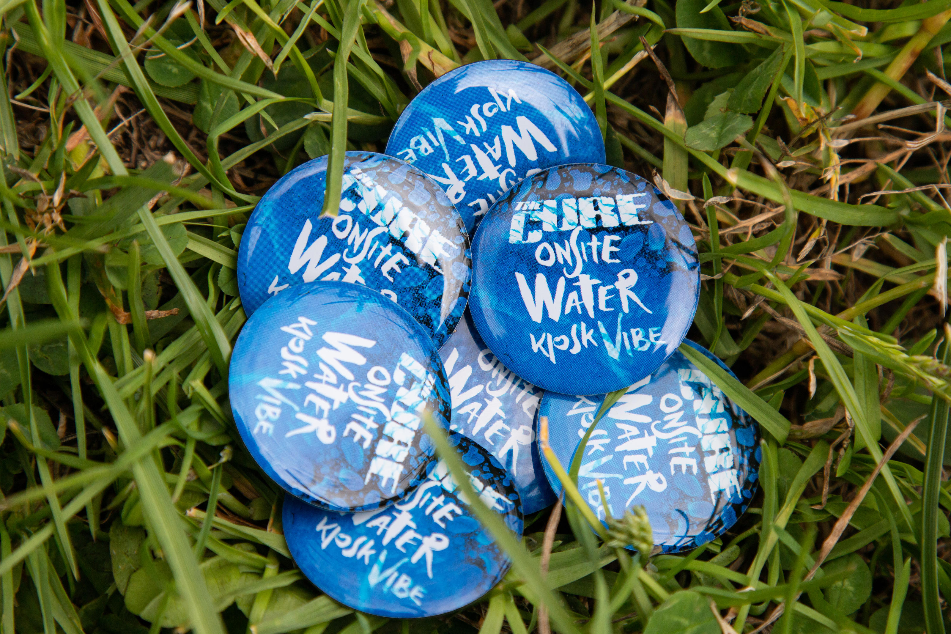 The Cure - Onsite Water Kiosk Vibe - pin badge design for Glastonbury