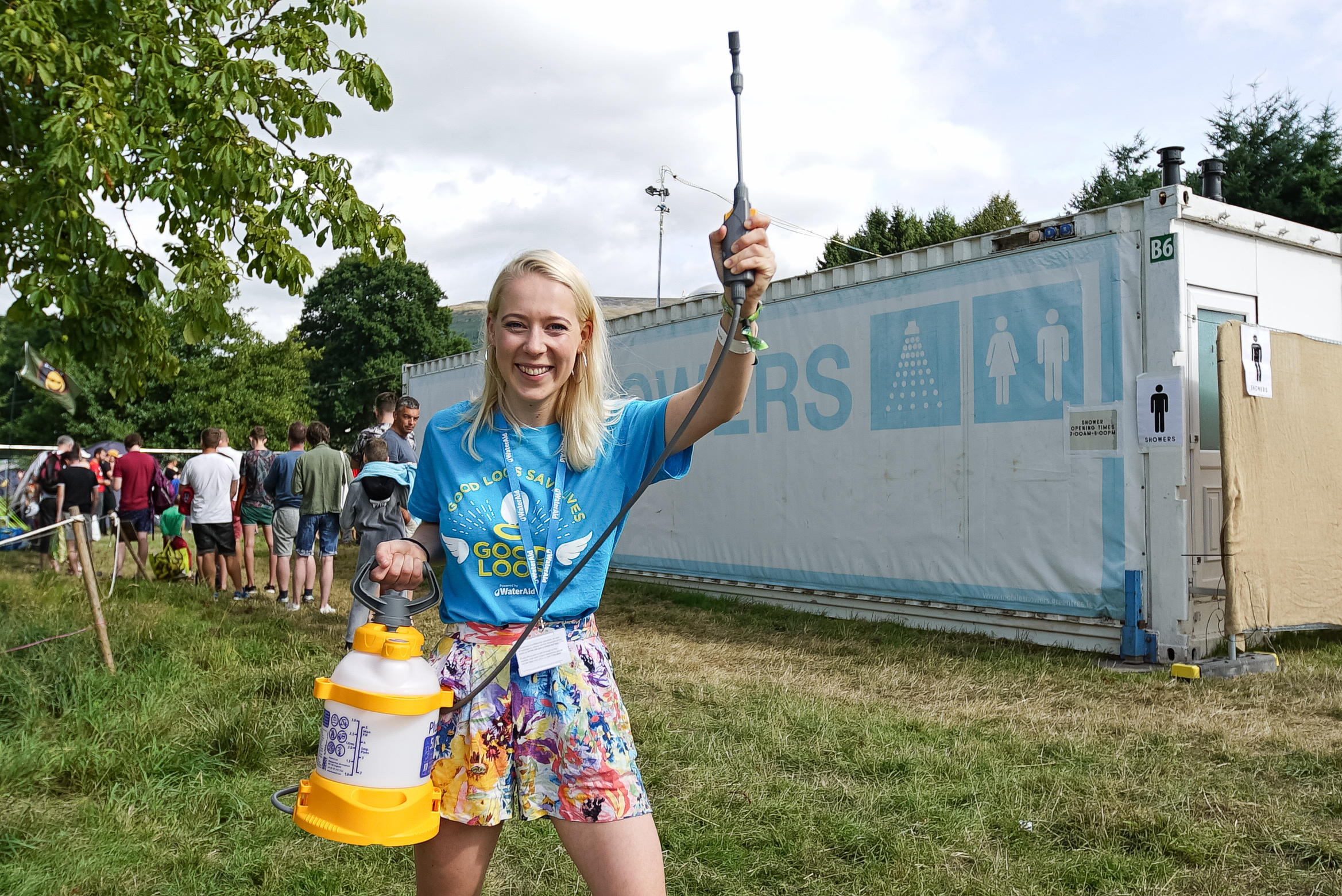 A WaterAid volunteer cleans the eco showers at green Man festival
