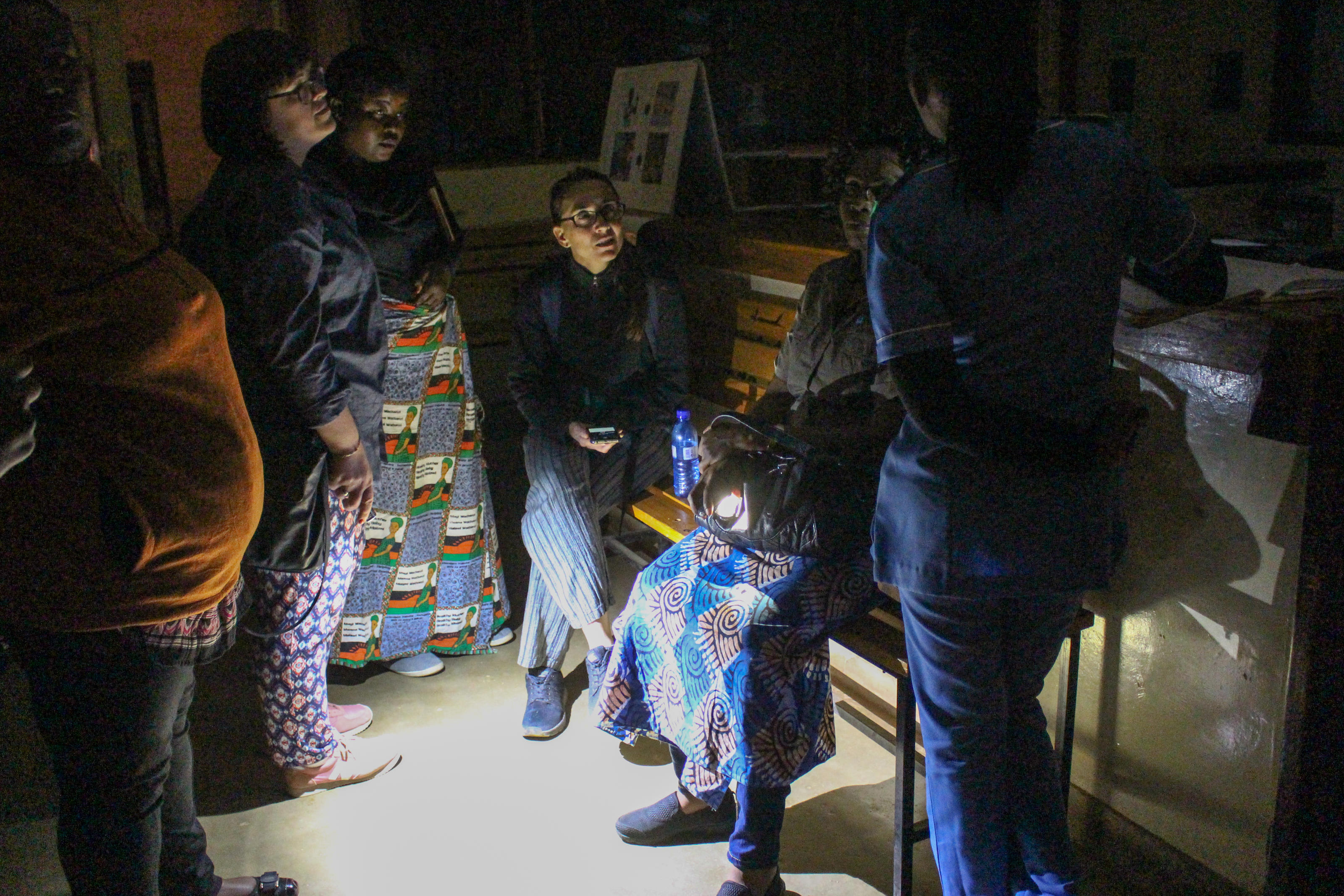 In the middle of a 12-hour power blackout, a nurse briefs the WaterAid team on how the maternity ward is run without electricity, clean water or decent toilets.