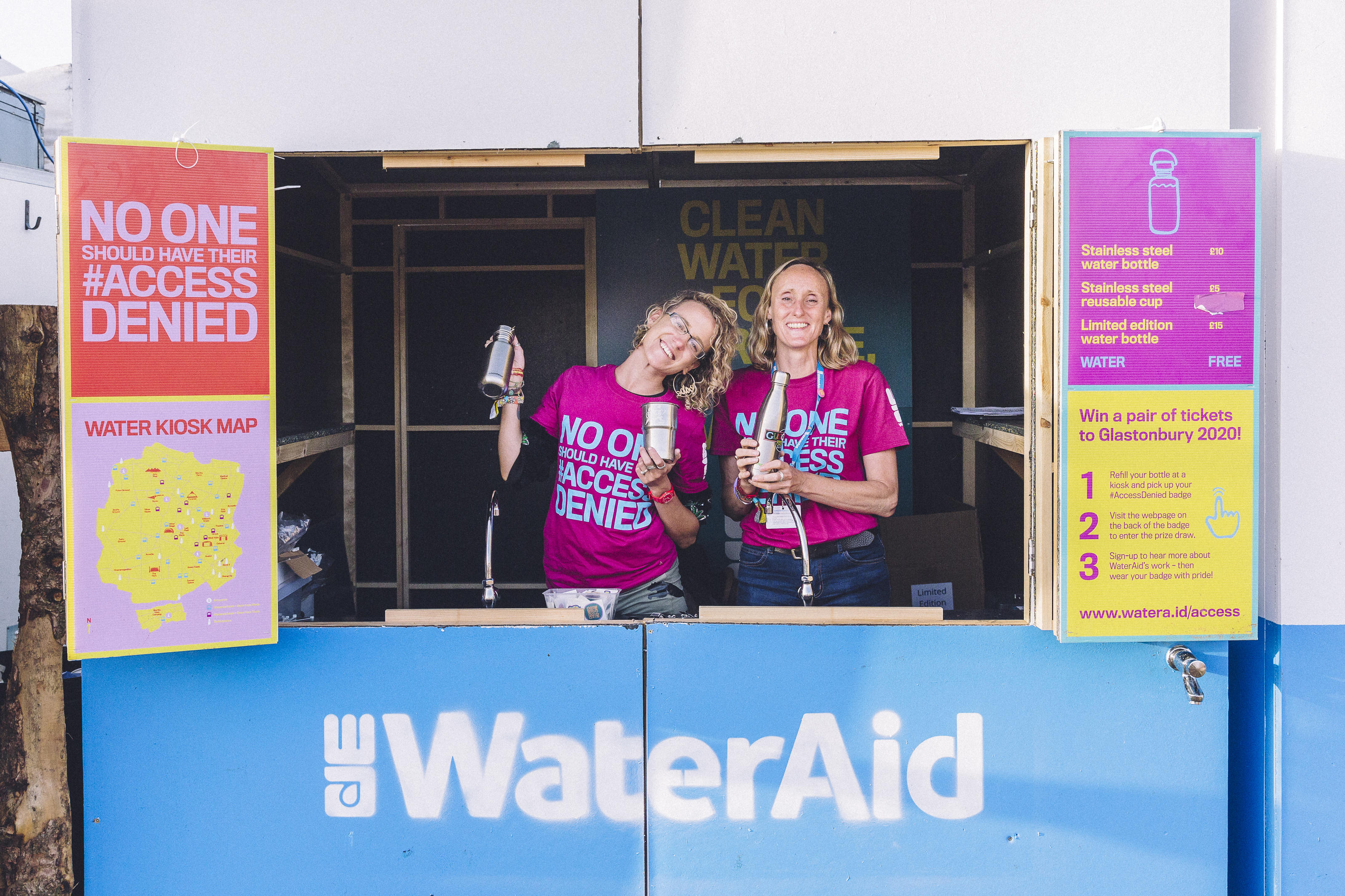 WaterAid volunteers Harriet Clark (left) and Nadia Williams (right) staff a refill kiosk at the 2019 Glastonbury Festival.
