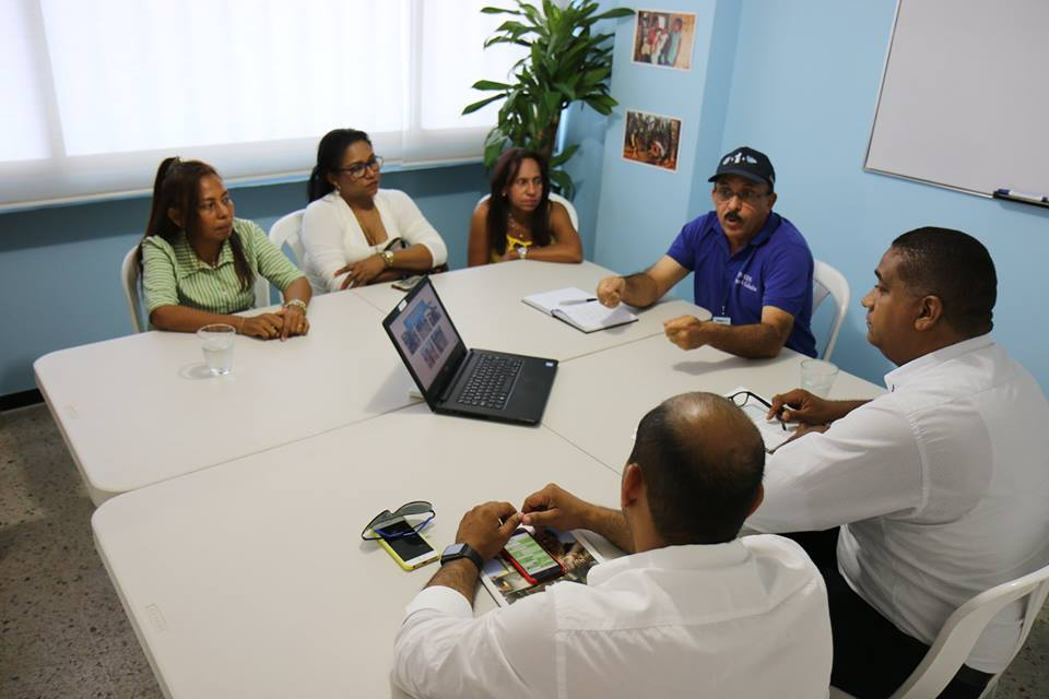 WaterAid staff talking with other key actors in WA Colombia office.