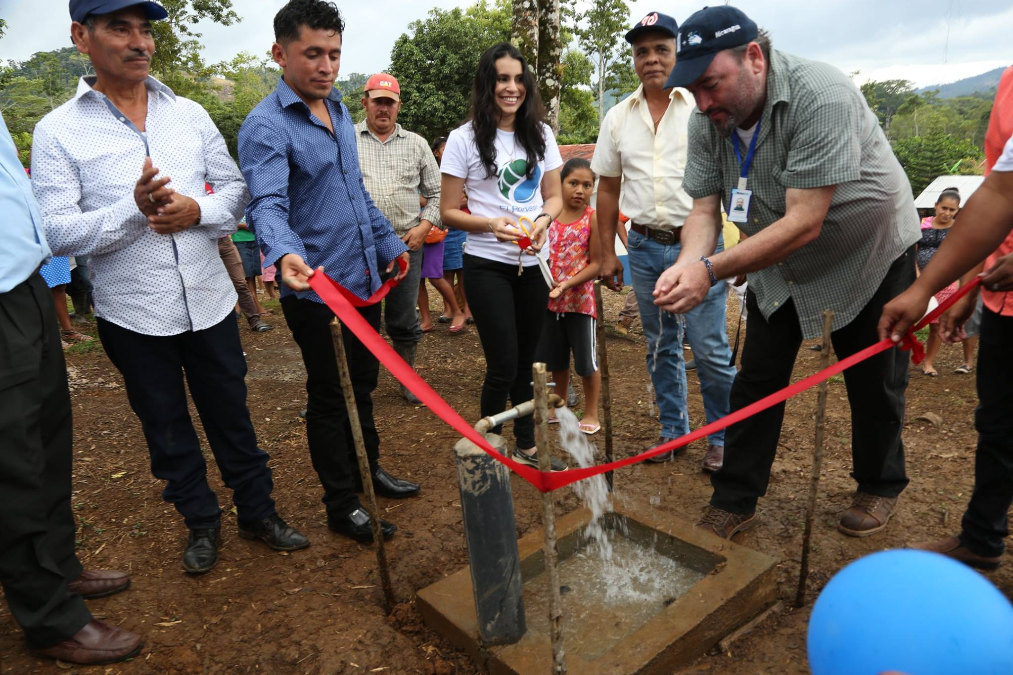 Inauguration of a water project in Nicaragua; staff cut the ribbon.