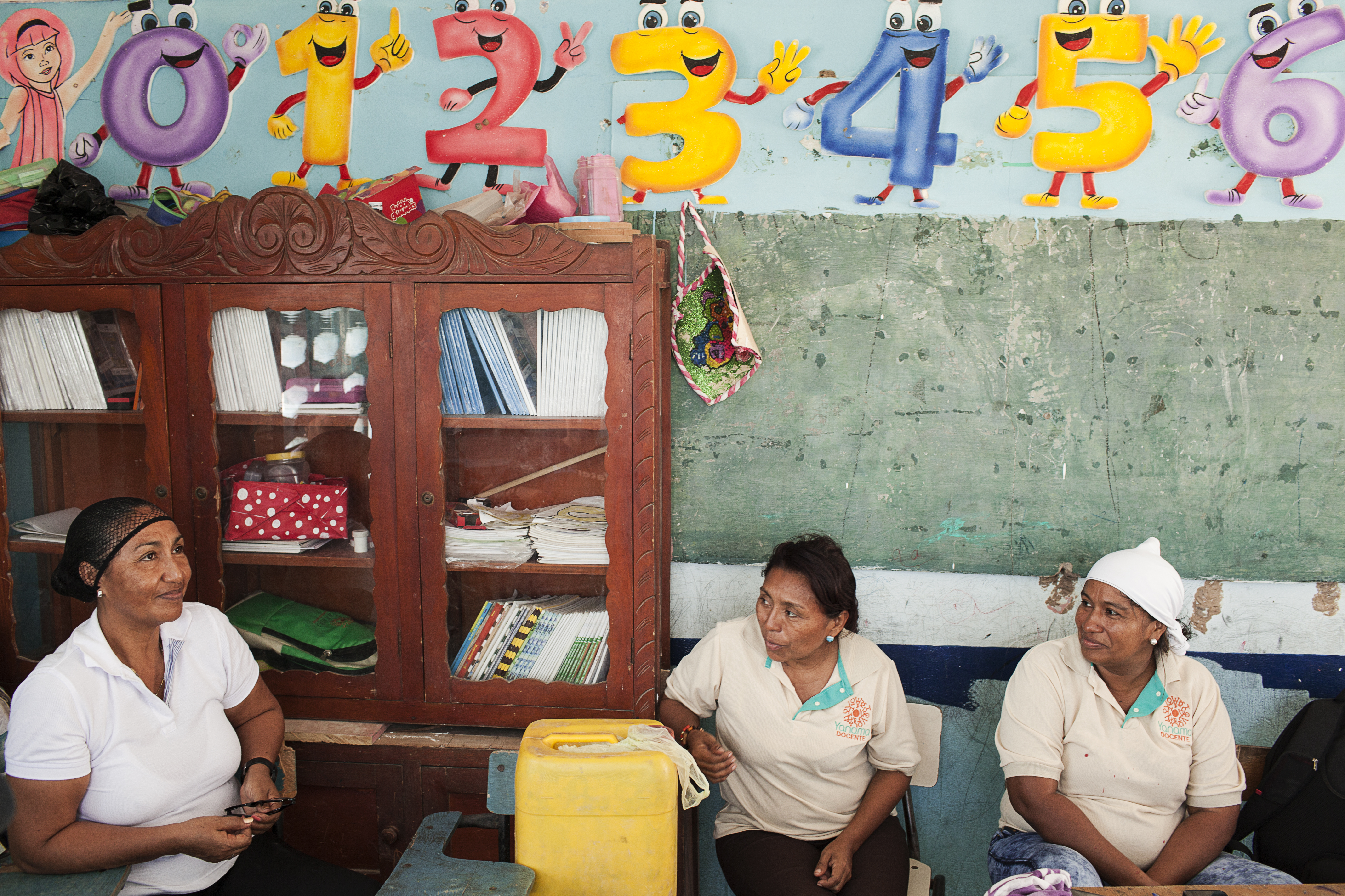(L-R) Laila Moscote Epinayu, 50, Solmaris Rodriguez, 41 and Germina Rodriguez Iguaran, 43, all teachers at Totcomana school, Totcomana, Manaure, La Guajira, Colombia. March 2017.
