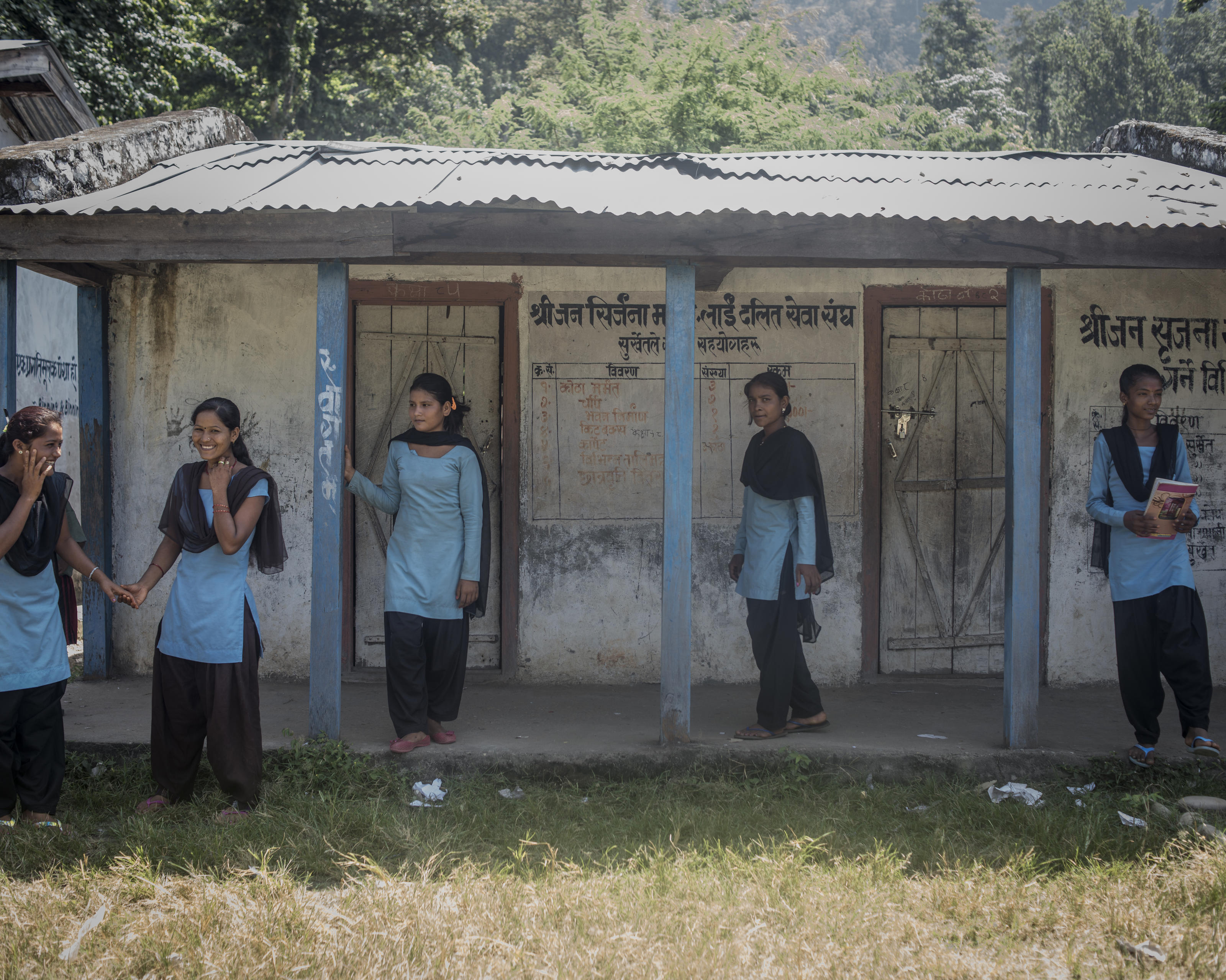 Schoolgirls outside their school, at least three of these educated girls in the group still observe the practice of Chaupadi, Tatopani School, Tatopani, Nepal, 2013.