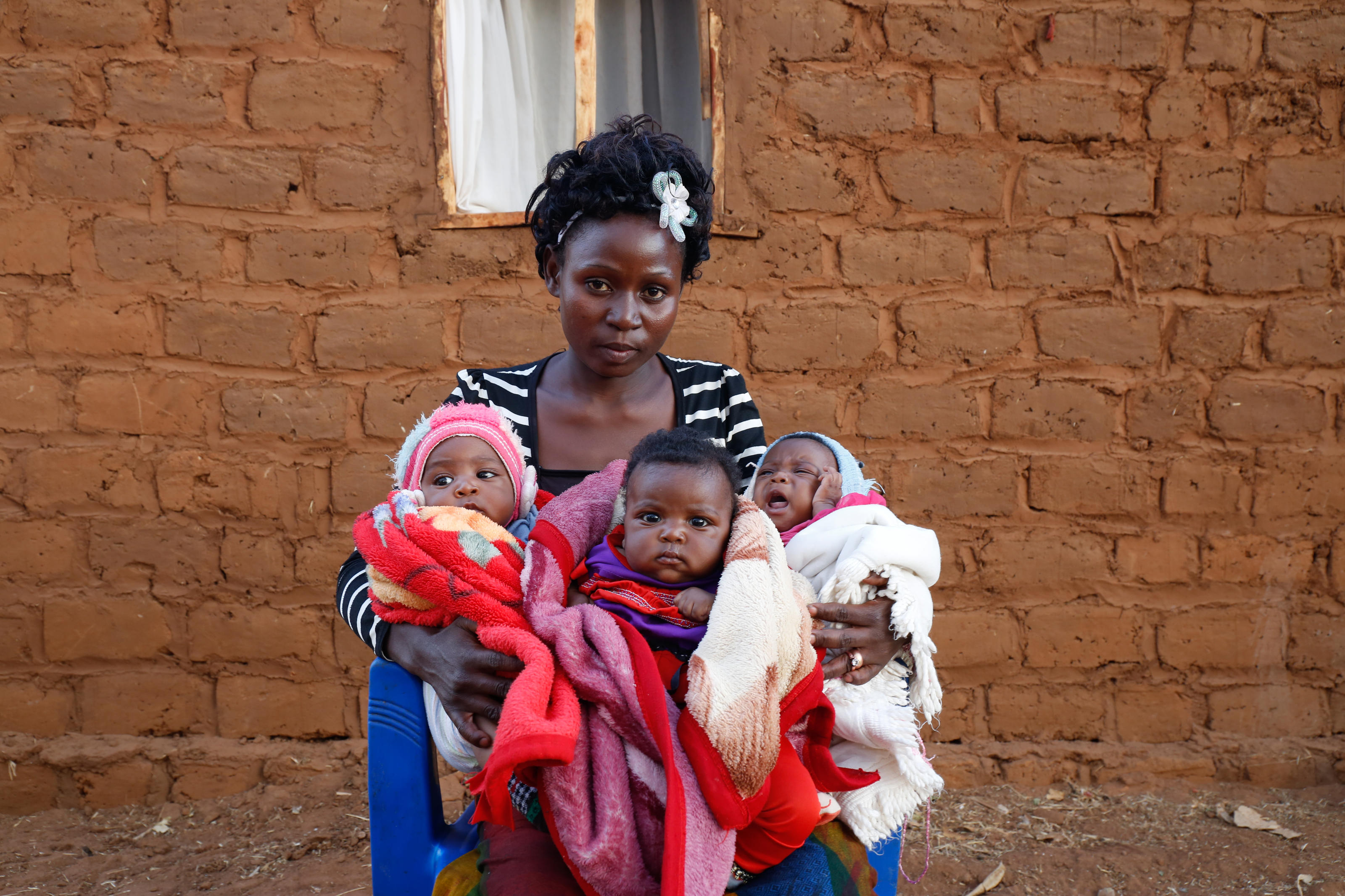 Mary and her newborn triplets at hospital, Tanzania.