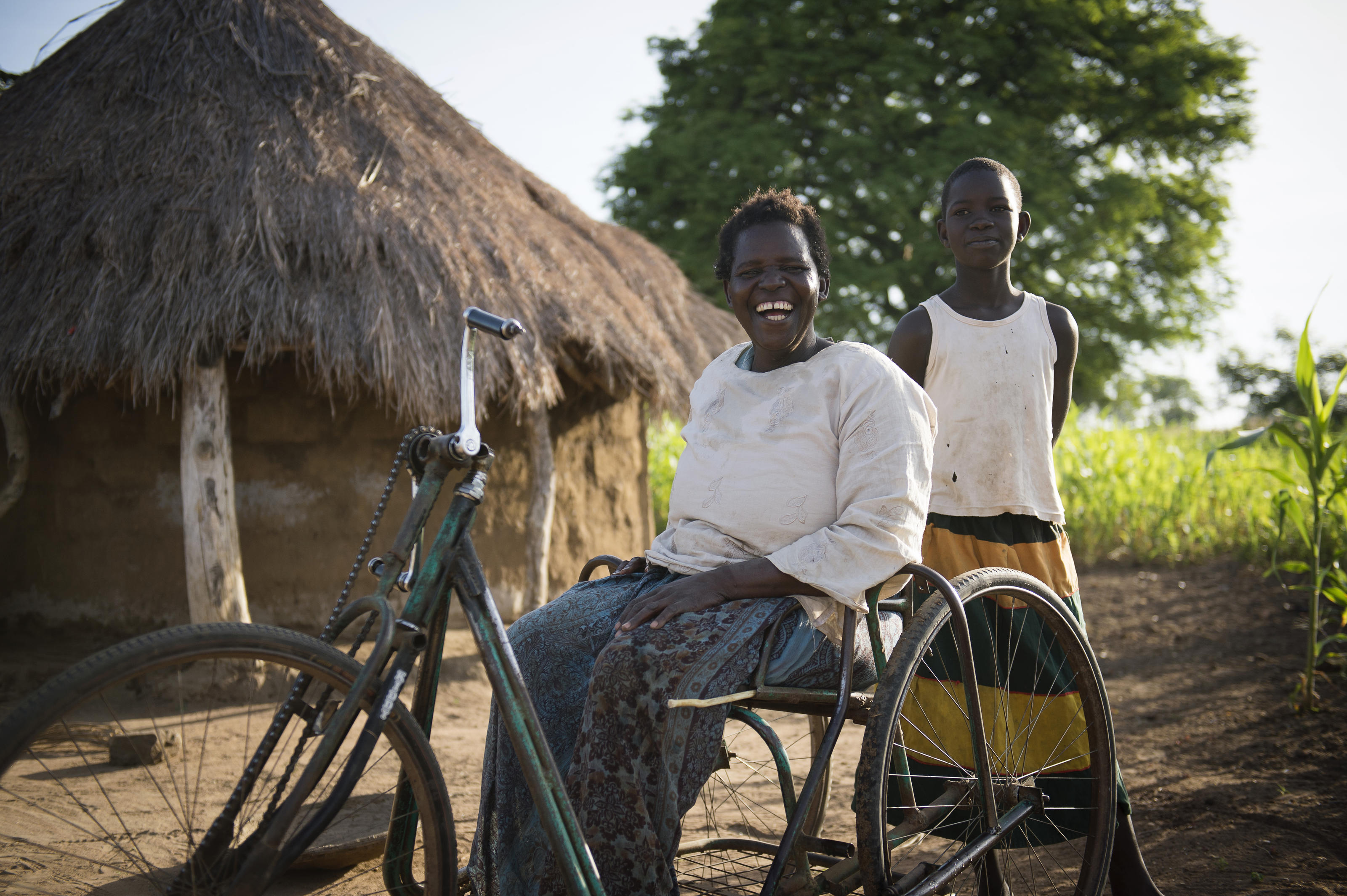 Margaret and her daughter outside their home, Uganda