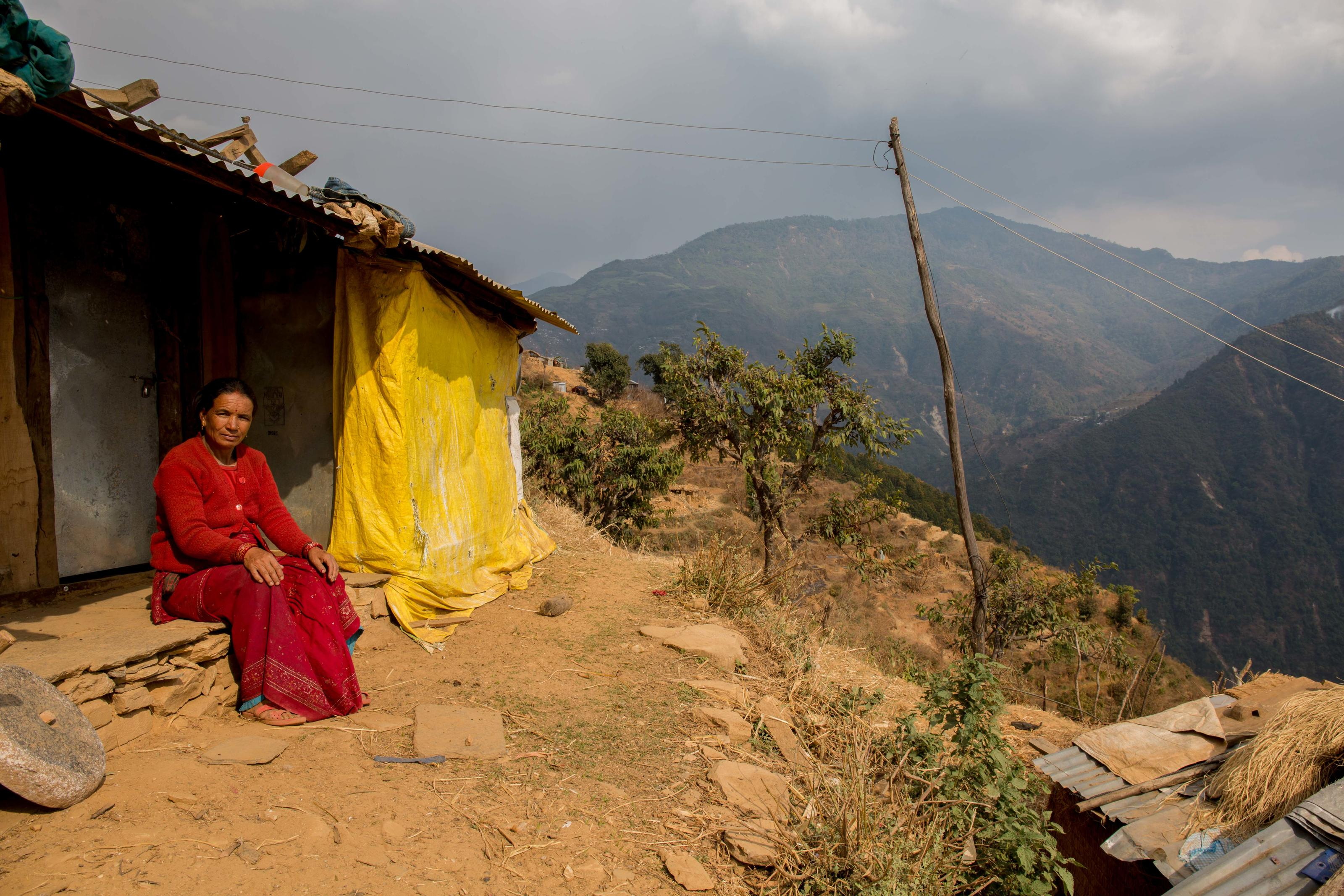 Ujelimaya at her newly built tin sheet home. Gorkha, Nepal.