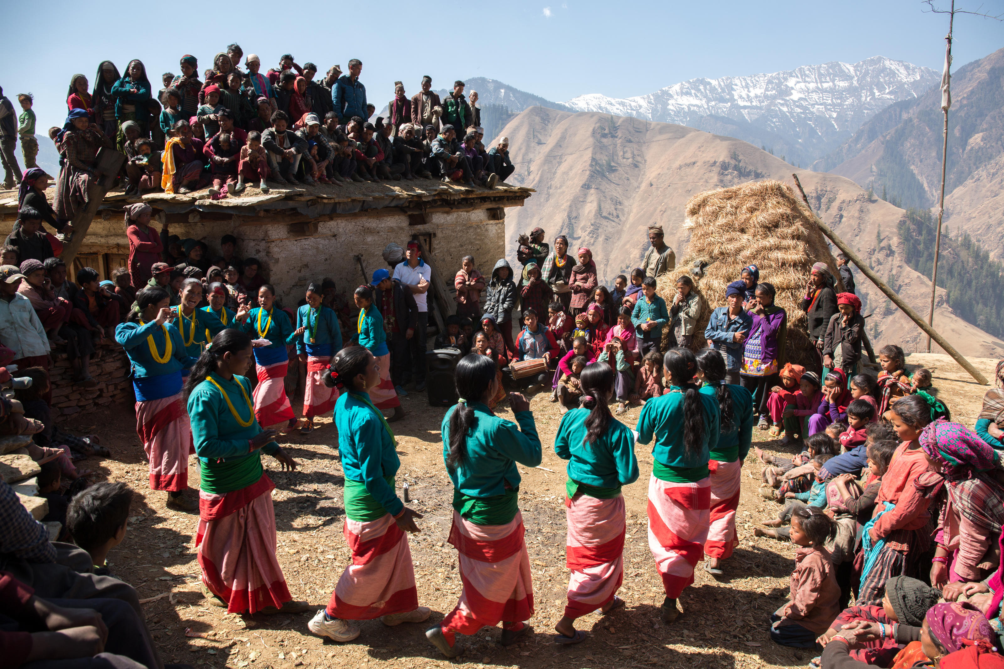 Local community performs a traditional song with a dance called 'Deuda'. Deuda dance and song is very popular in western region of Nepal. Baragaun, Nepal.