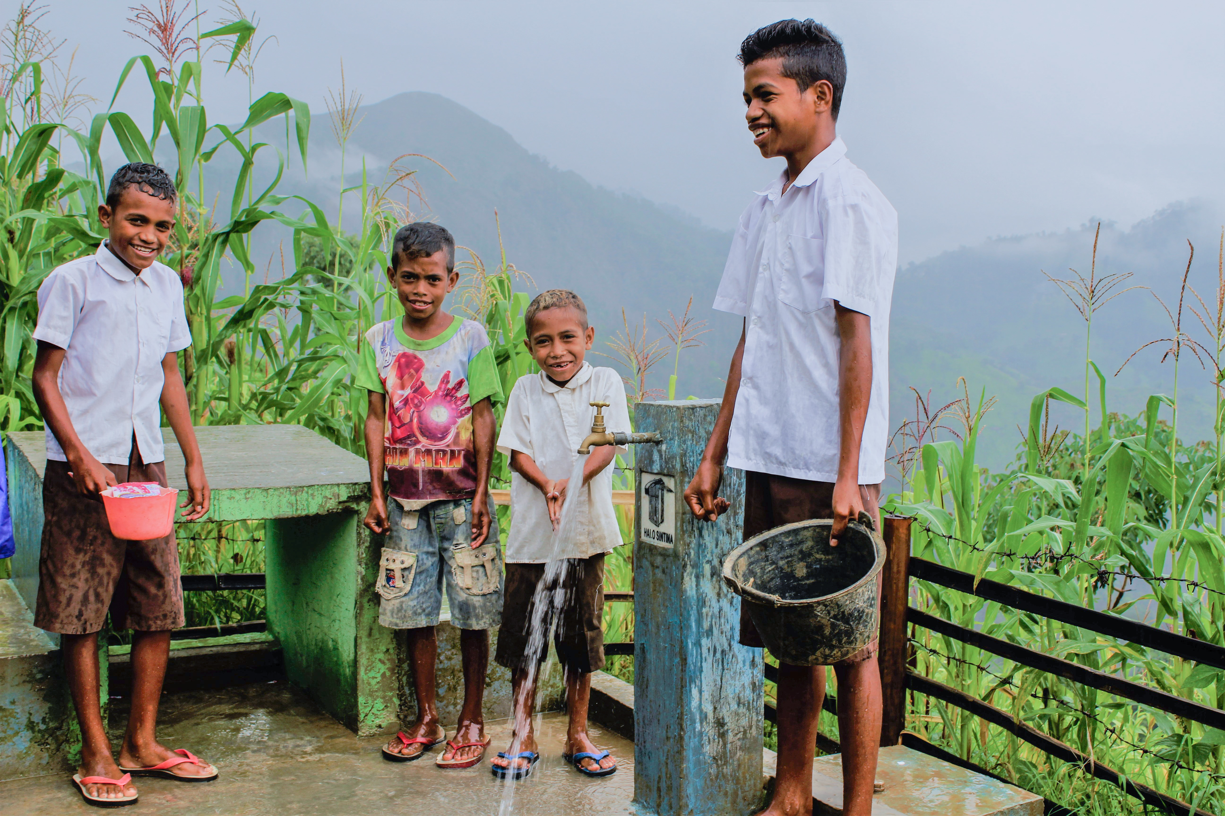 Kids in Timor-Leste collect water from the new water point