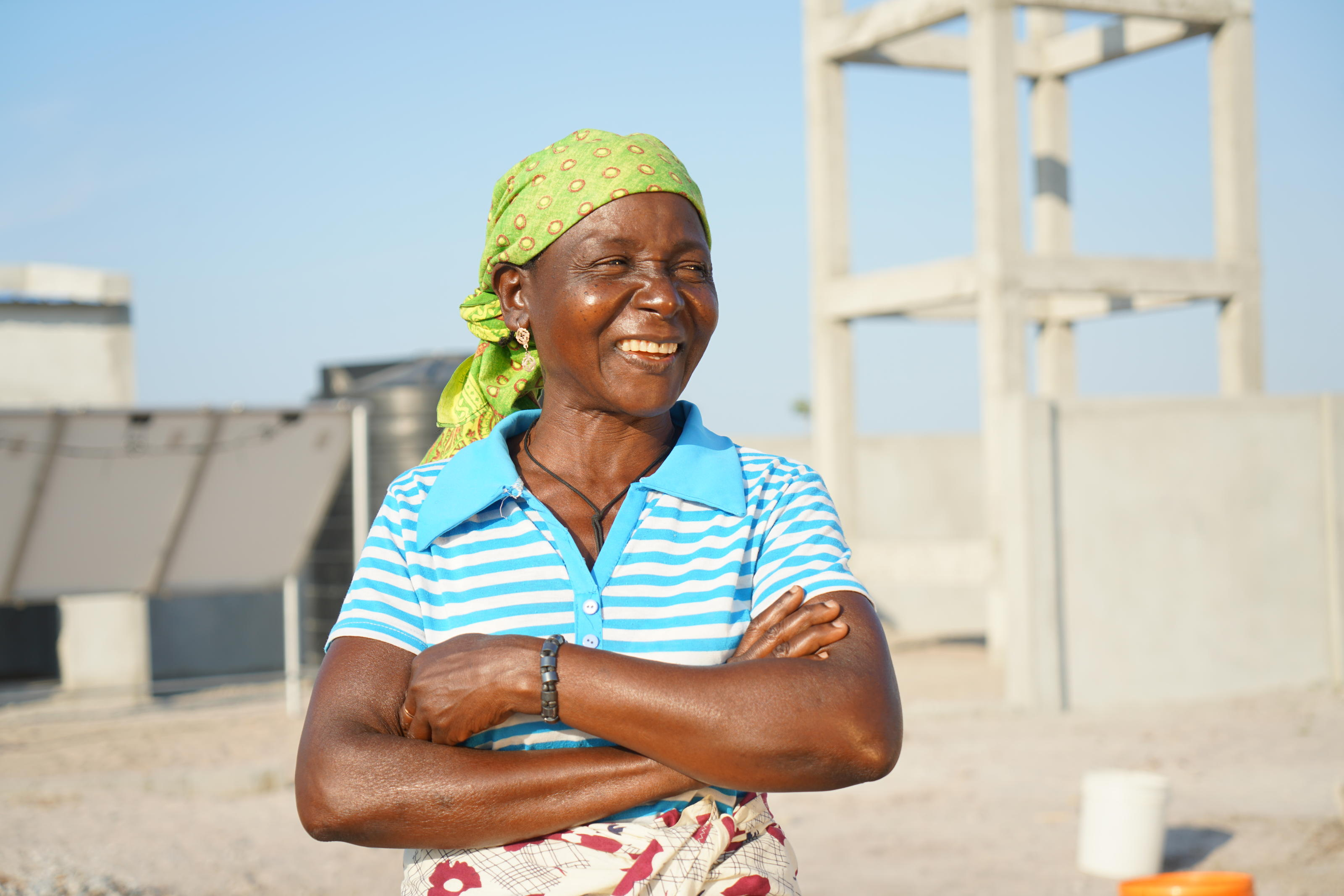 Molia Abdallah, 47, in front of a solar powered water scheme being constructed in Chicoma, Mossuril District, Nampula Province, Mozambique, October 2018.
