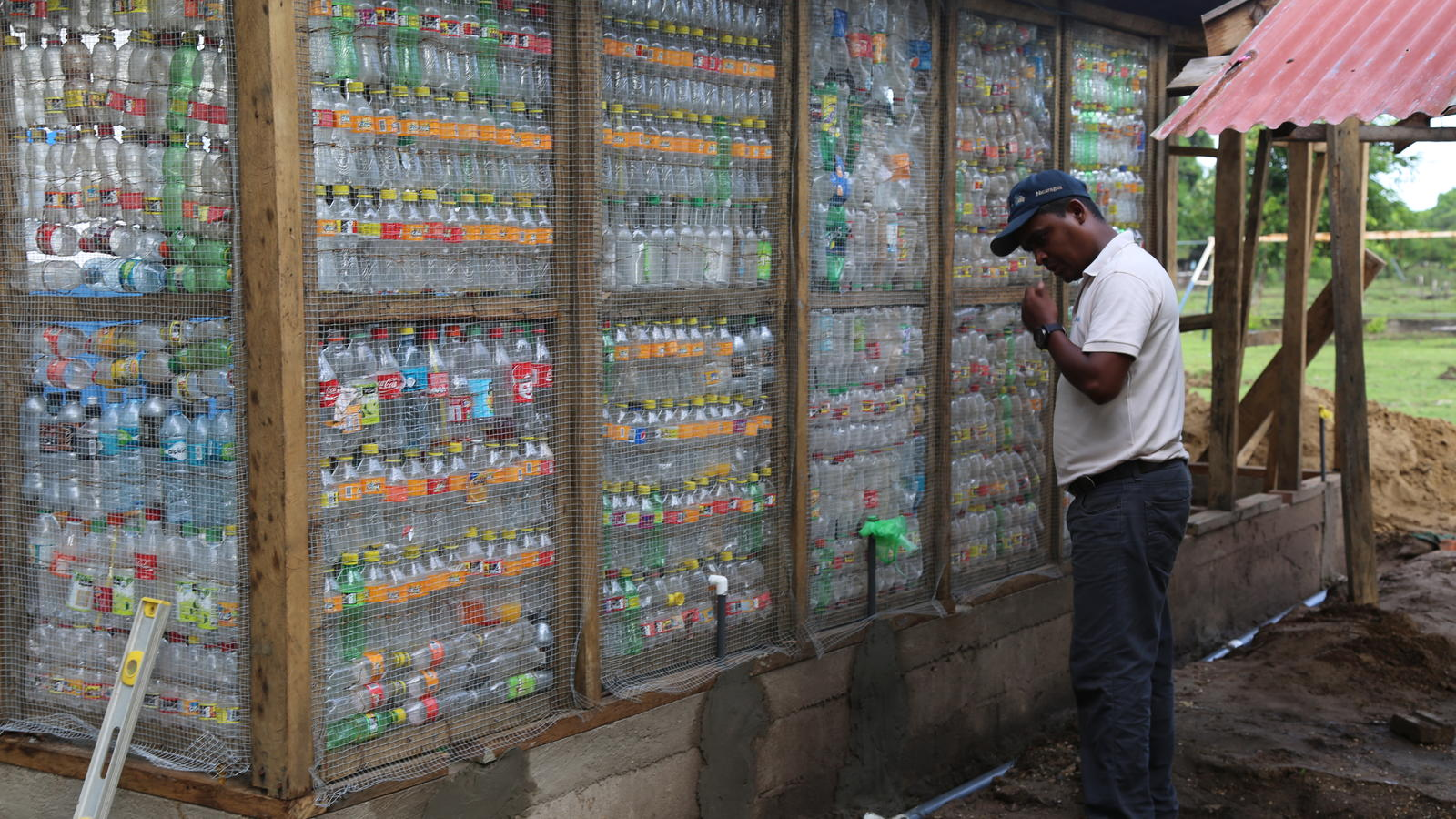 Recycled bottles used in the walls of sanitation modules in Tuapi.