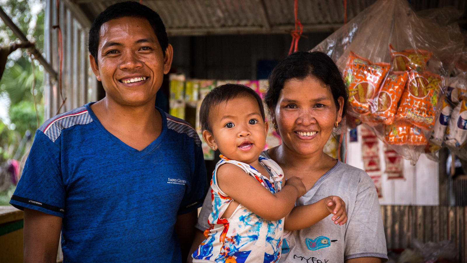 Mor Tei, 32, with wife Roeung Mom, 33, and daughter, Khaun Sreymuch, 2, Beng Village, Pursat, Cambodia, Feb 2018