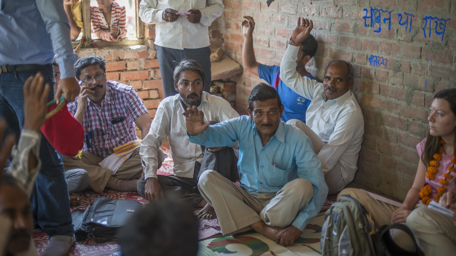 Local men play a menstrual hygiene awareness card game in Duggor, India.