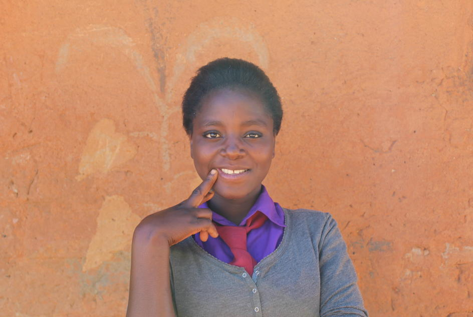 Claudia photographed in her school in Lubunda, Zambia, after filming a version of the song Sunshine on a Rainy Day.