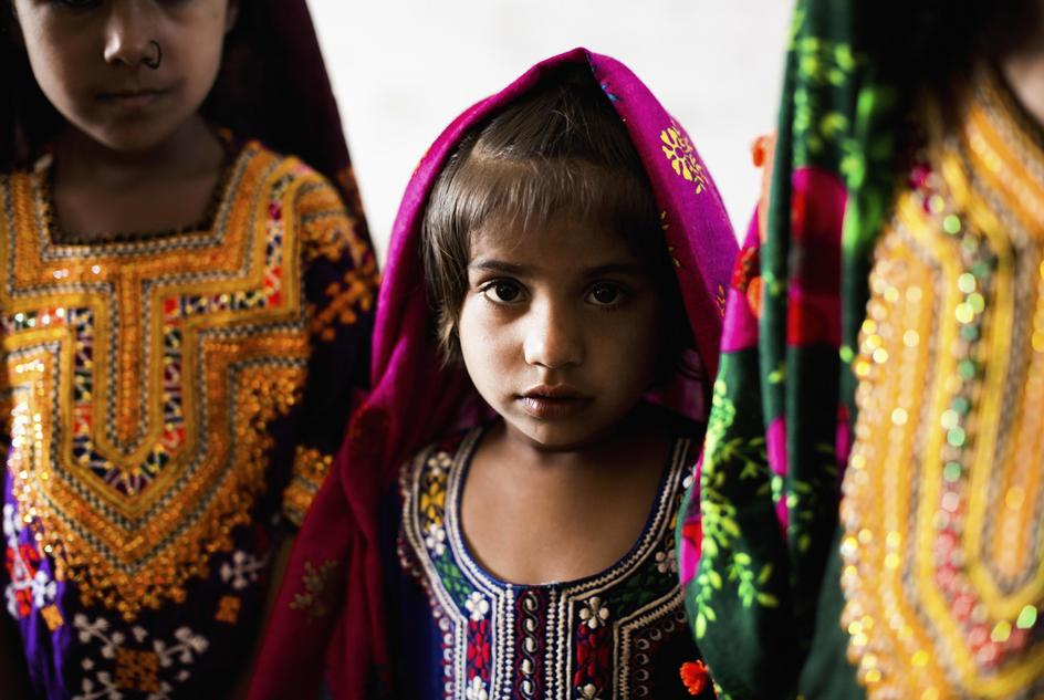 Four-year-old Benazir attends class with boys and girls of different ages in Haji Saleh Jatt, Thatta, Pakistan.