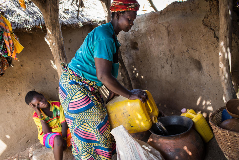 Sedgaa , 40, brews beer from sorghum at her home in Burkina Faso.