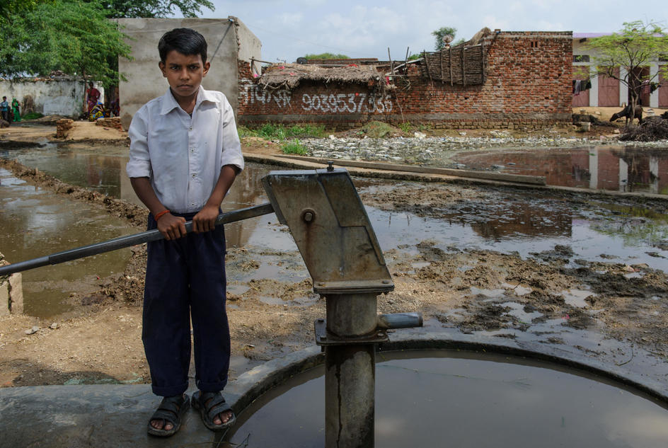 Pradeep (10) by unsafe hand pump in Narai Ka Pura village in Madhya Pradesh India. August 2015Pradeep uses an unsafe water pump in Narai Ka Pura, Madhya Pradesh, India.