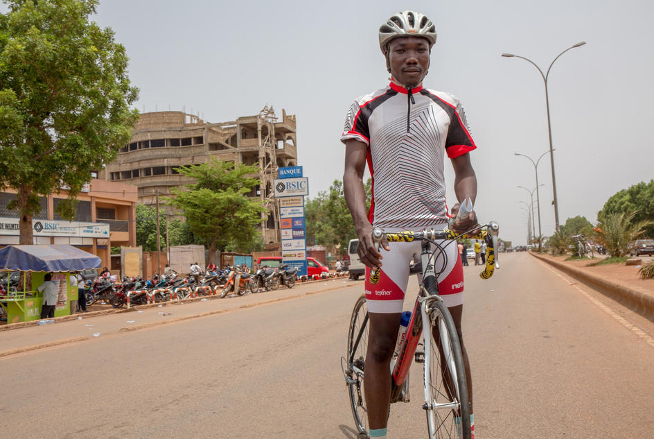 Issaka , a professional racing cyclist on his bike in Burkina Faso.