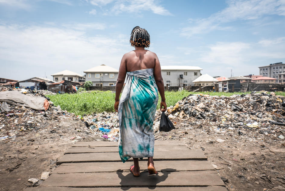 37-year-old Modinatu Sofola looks out into the new apartments from her home in the slum of Ajeromi-Ifelodun in Lagos, Nigeria.