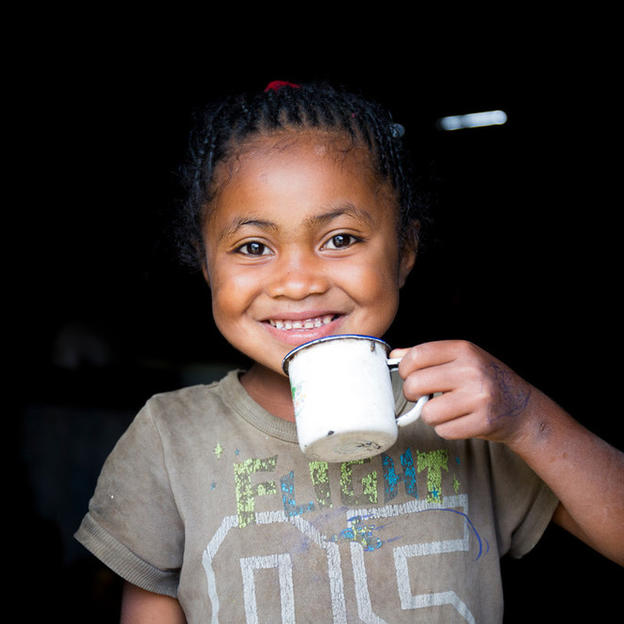 A girl drinks clean water in Madagascar