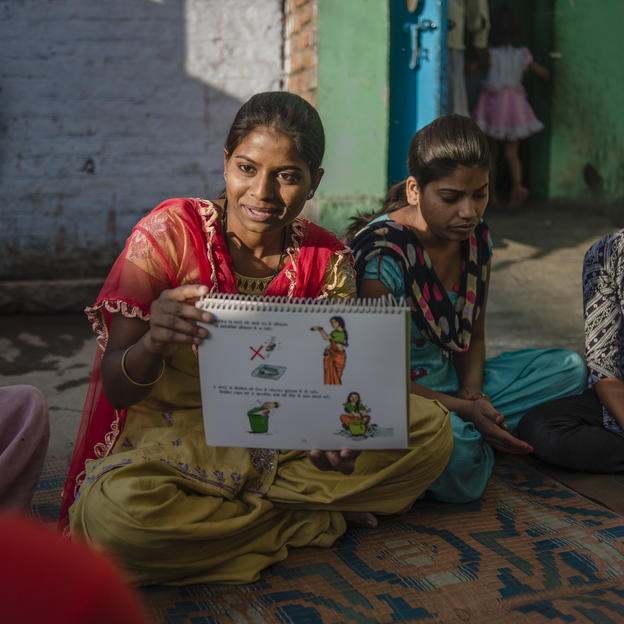 A community leader teaches menstrual hygiene to women in Kanpur India.