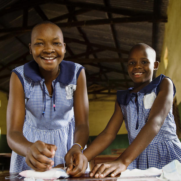 Girls learn how to make sanitary pads in Uganda (WaterAid/ Eliza Powell)