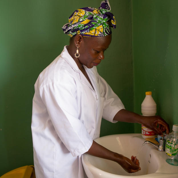 Nurse washes her hands at health center in Mali.