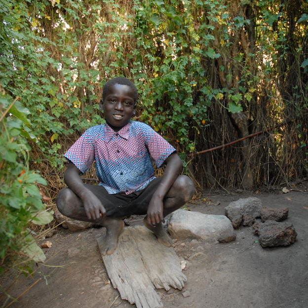 Solomon in his latrine in Uganda