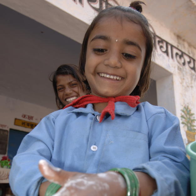 Pinki washing her hands, Premnaga School, Panchat Nathurpa, Mahoba district of Uttar Pradesh, India