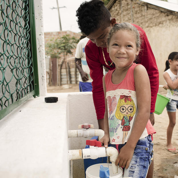 Maria Fernanda Rua Dita, 6, collects water from WaterAid's water point in Comejenes, Riohacha, La Guajira, Colombia, March 2017