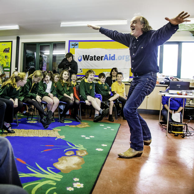 Children celebrate the launch of the WaterAid poetry competition, Testwood Lakes Centre, Hampshire, UK, 2013.