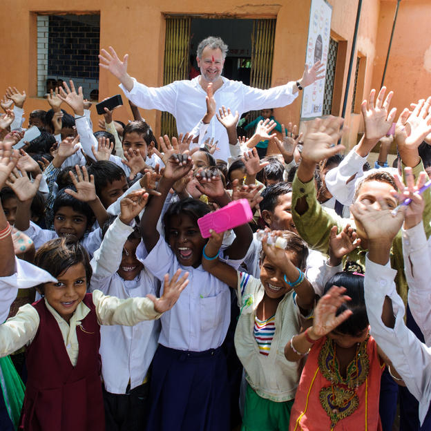 Hugh Bonneville visits a primary school in Madhya Pradesh, India.