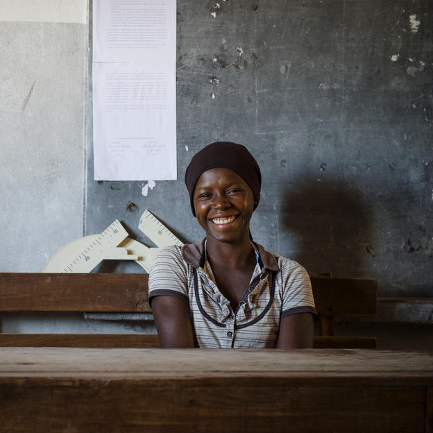 Bina, 15, sits at her desk in Chicoma Primary School in Chicoma Village, Mossuril District, Nampula Province, Mozambique, October 2017.