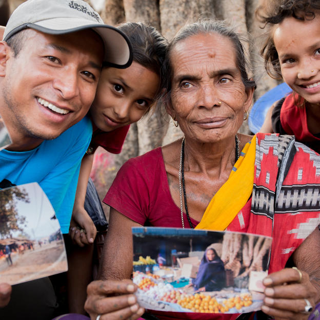 VftF Officer-Mani Karmacharya with the community members while distributing their photos from the previous visit. Sirthauli, Sindhuli, Nepal, April 2016