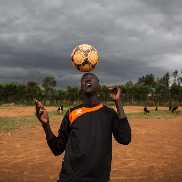 Jean-Bosco practices his football skills at Group Scholaire Kibungo, Rweru, Bugesera, Rwanda, February 2018.