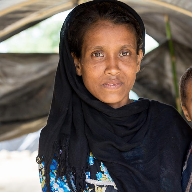 A Rohingya woman and her small child pose for a photograph after making the perilous journey from Myanmar.  Pregnant women who lack pre-natal care, new mothers delivering babies without access to water or good hygiene, and babies and small children, are at particular risk from illness and infection