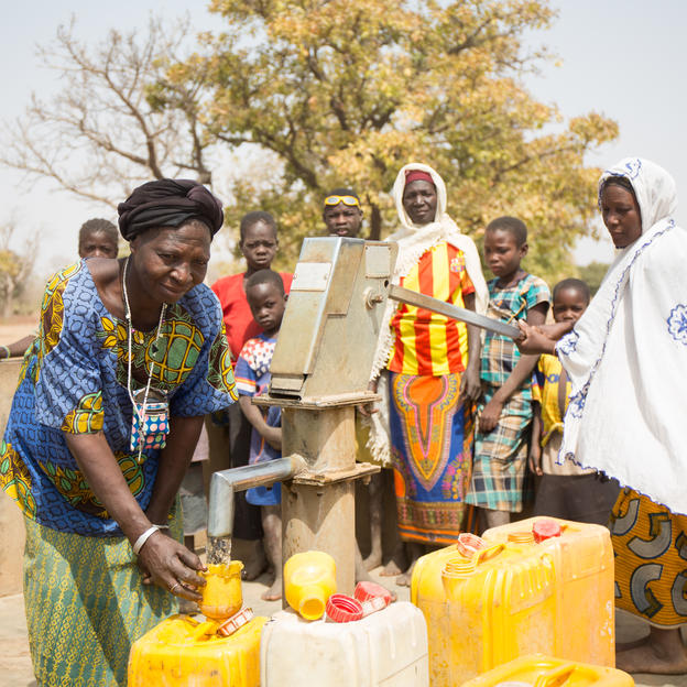 Community members collect water at a borehole installed by WaterAid in the Centre-East region of Burkina Faso. WaterAid/Basile Ouedraogo