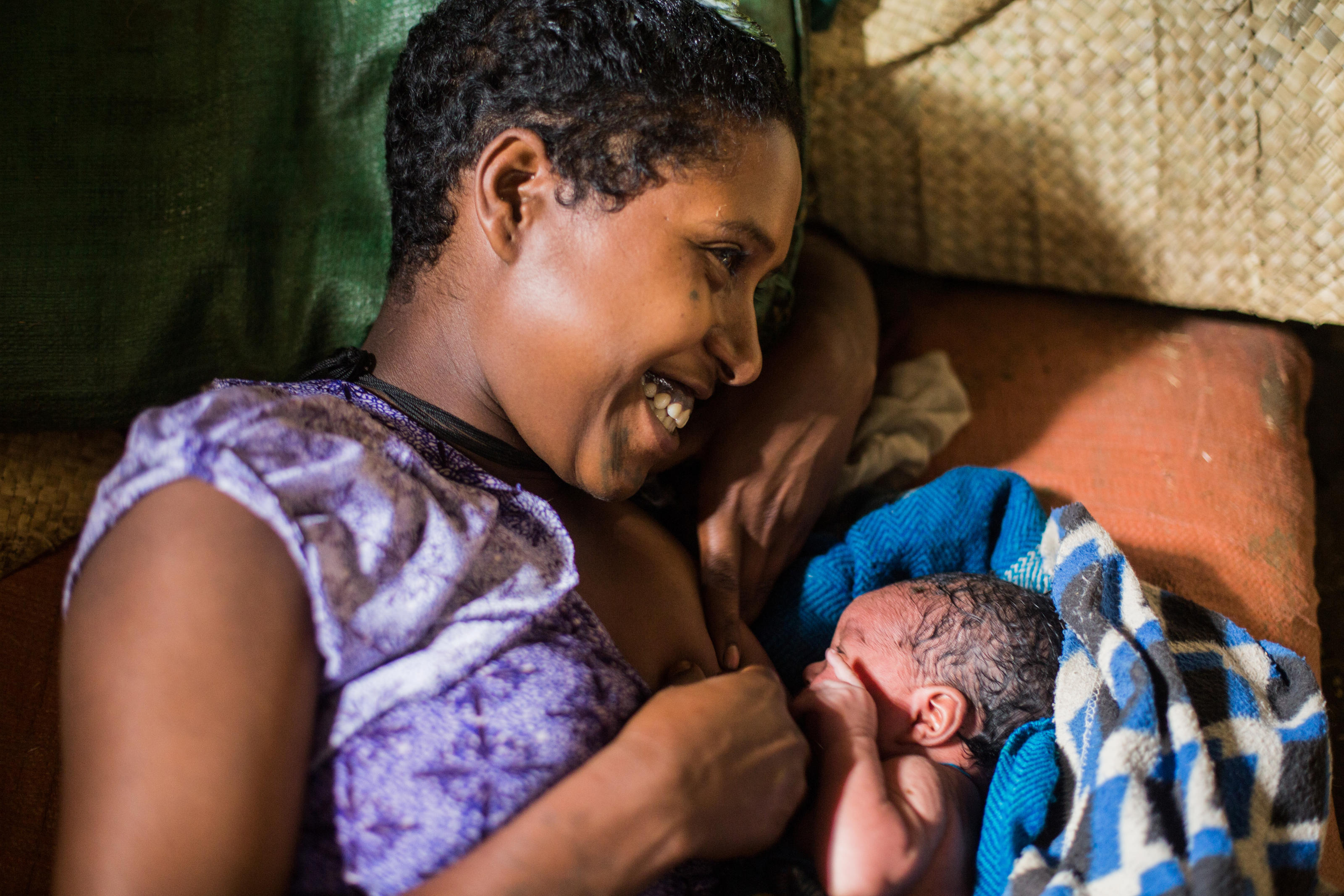 Tiru Tefera, 18, with her recently-delivered her first son born at Yiraber Health Centre, Jabi Tehnan, West Gojjam, Ethiopia, December 2018.
